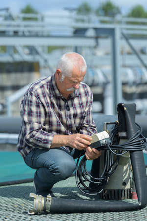 an engineer working on checking and maintenance equipment water plant Stock Photo