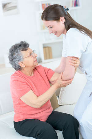 old lady with walking problem and her carer