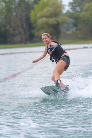 young woman water skiing on a sea Stock Photo