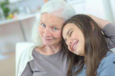 grandaughter: grandma hugging her grandaugther Stock Photo