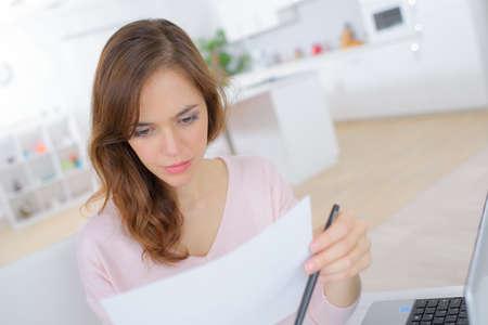 smiling beautiful female college girl student doing homework Stock Photo