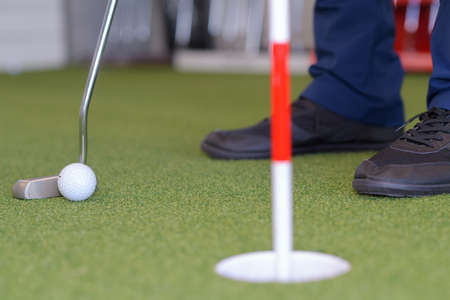 focus on foreground: close up indoor golf