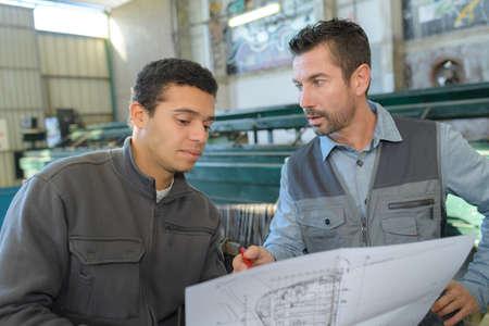 illustrates: supervisor evaluating the design Stock Photo