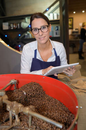woman choosing the coffee beans of the best quality