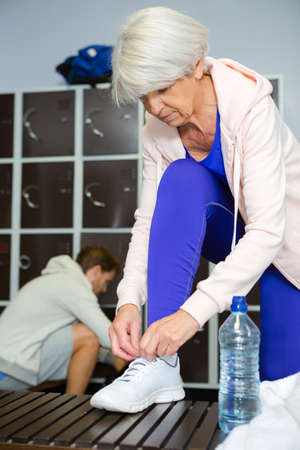 Senior woman in the locker room Stock Photo