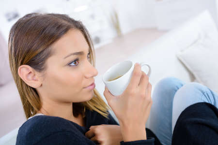 Beautiful woman enjoying the smell of coffee in the morning Stock Photo