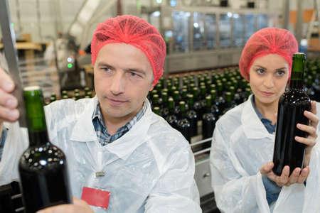 employees bottling wine