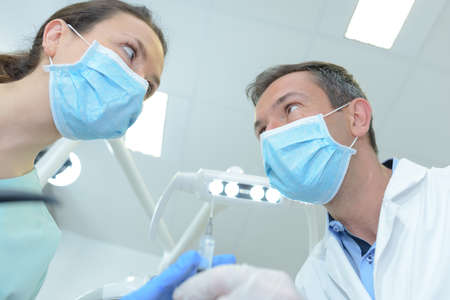 male dentist and his female assistant