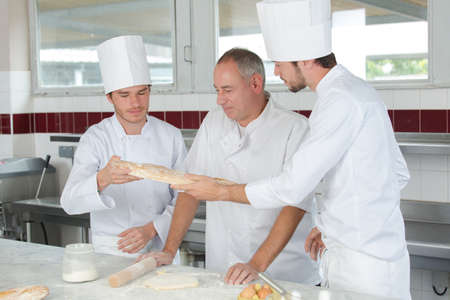 19 year old boy: students training to work in catering industry Stock Photo