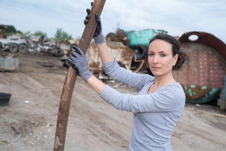 female working at scrap metal yard