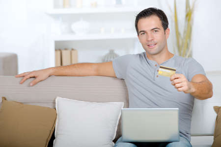 Man holding a credit card online shopping