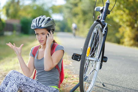 woman calling for help after having a bicycle accident