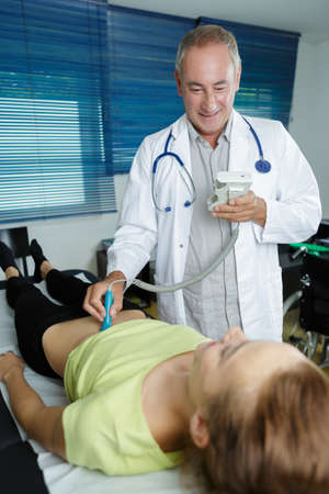 male doctor examining a patient Stock Photo