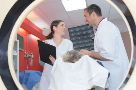 doctor giving instructions to technician for carrying out mri scan Stock Photo