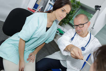 diagnoses: Healthcare and medical concept - doctor and nurse with patient