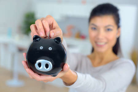 coinbank: close-up of piggy bank in female hands Stock Photo