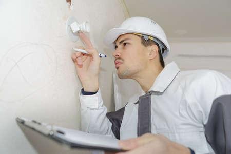 establishments electrician doing survey