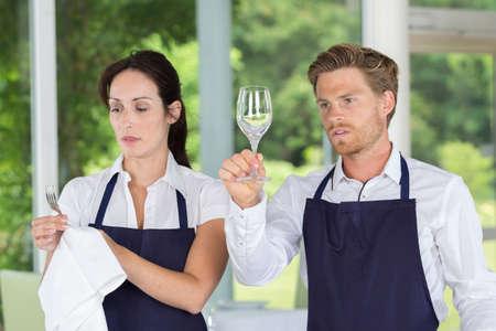 waitress and waiter working in bar Stock Photo