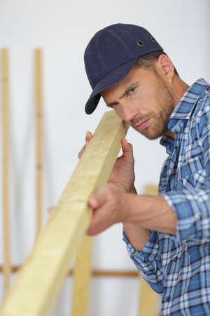 carpenter working on a plank of wood in his workshop Stock Photo
