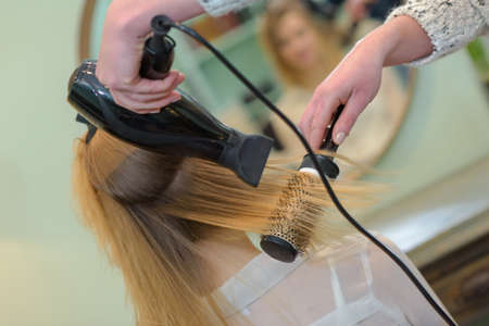 professional hairdresser drying hair Stock Photo