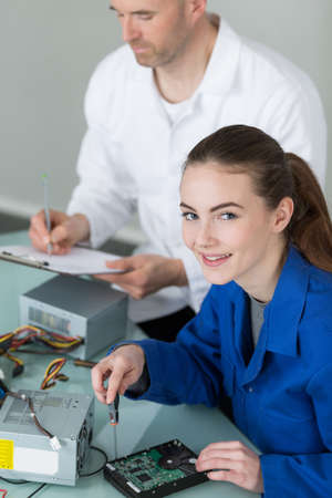 female electrician student with teacher Stock Photo