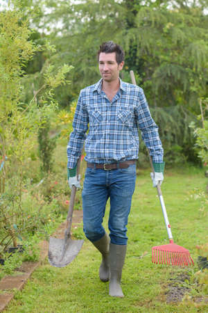 dibble: portrait of a handsome man gardener on a lovely day