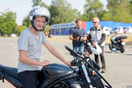 young motorcyclist gets ready to start exercise