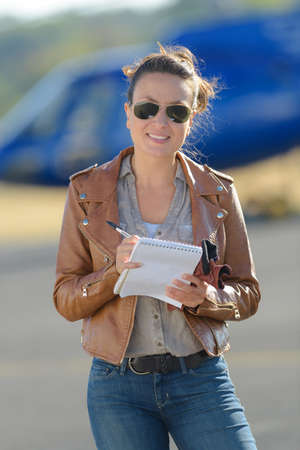 female pilot with helicopter