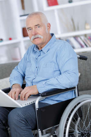 old man using a laptop Stock Photo