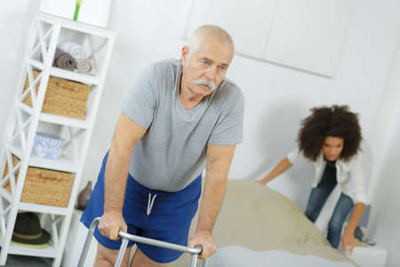 old senior man with walker in a nursing home