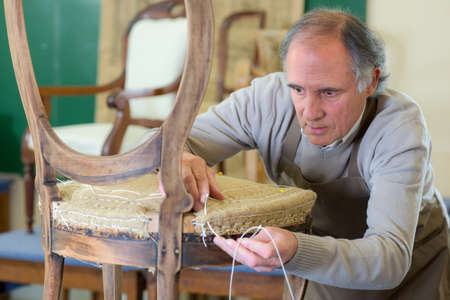 Man uplholstering chair