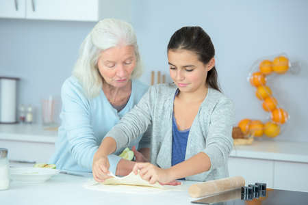 the grand daughter: bonding between granny and grand-daughter Stock Photo