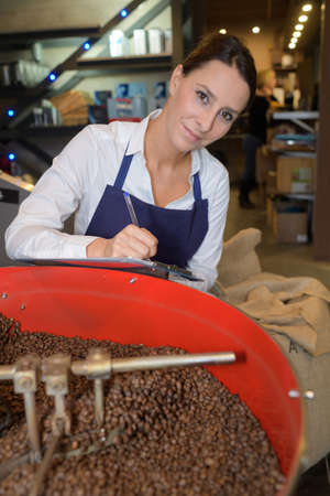 choosing the beans of the best quality at coffee factory