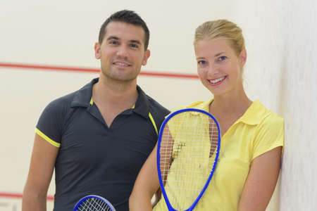 double game: squash player couple posing