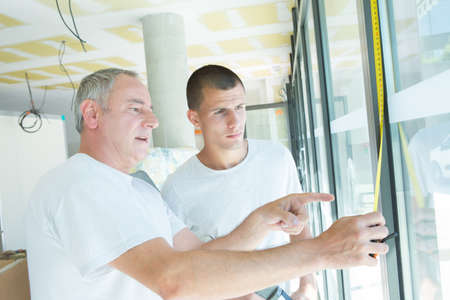 windows installation teacher and apprentice Stock Photo