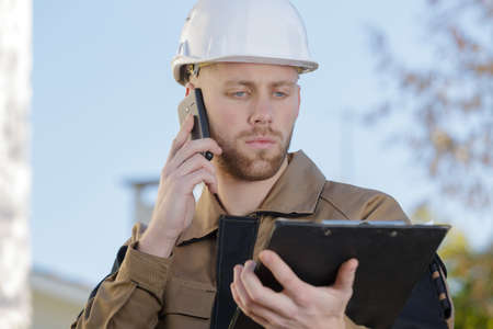 construction agent relaying the information Stock Photo
