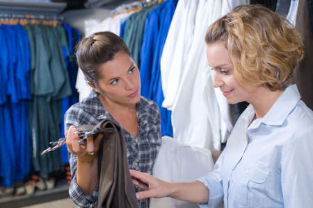 shopping buddies: two female friends clothes shopping