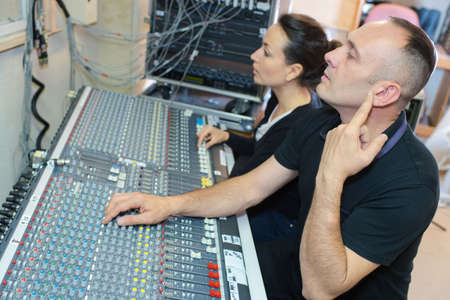 sound engineer and producer working together in studio