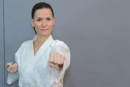young black belt fighter training karate