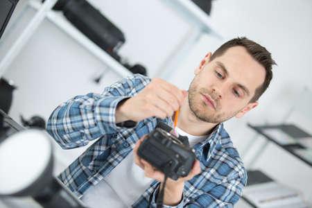 photographer fixing camera