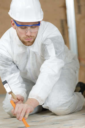 plasterer: builder removing plaster Stock Photo