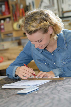 woman carpenter working in her workshop