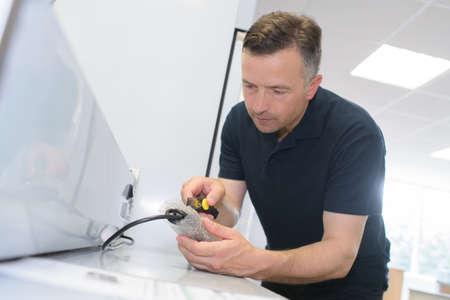 man calibrating equipment industrial Stock Photo