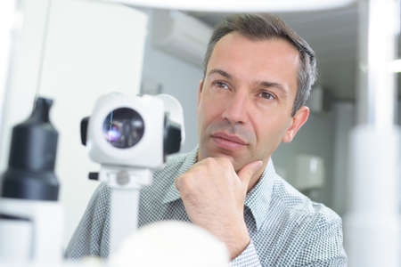 puzzled doctor thinking about the diagnosis Stock Photo