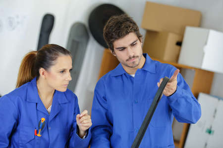 woman and man as bike mechanics in workshop