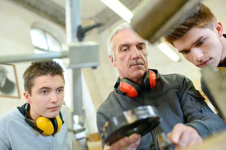 group of students in woodwork training course Standard-Bild