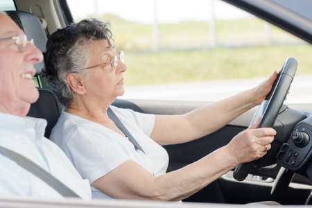 old woman and husband sitting inside the car Stock Photo