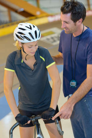 Cyclist with trainer