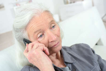 grizzled: sad old woman talking on the phone