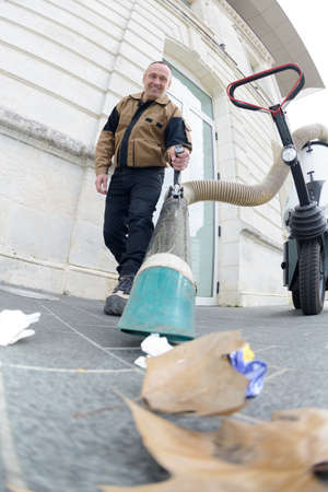 city worker cleaning the city streets Stock Photo